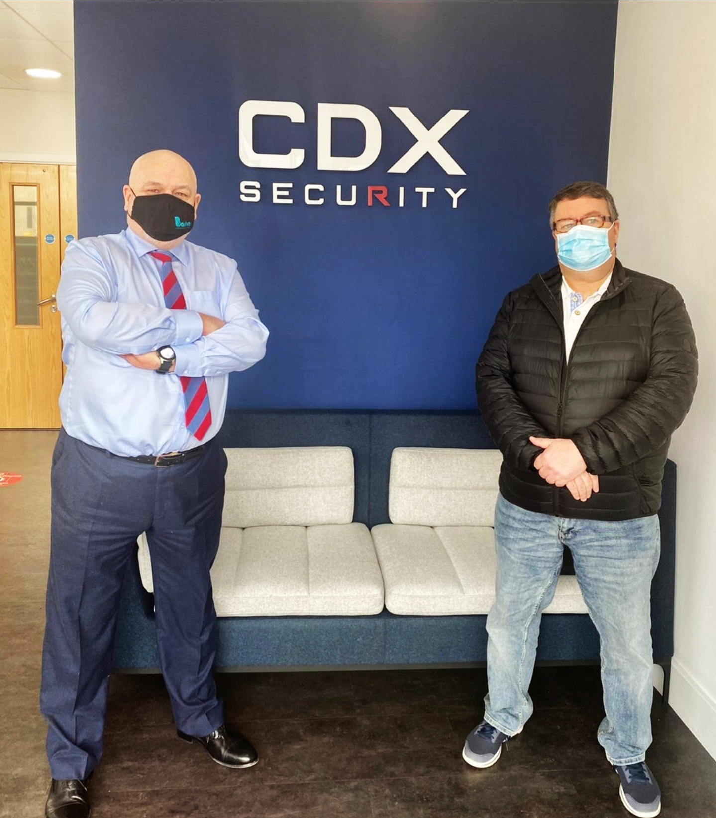 Sign of the times and all masked up –John Roddy (left),Group Managing Director, CDX Security and Oldham RLFC chairman Chris Hamilton