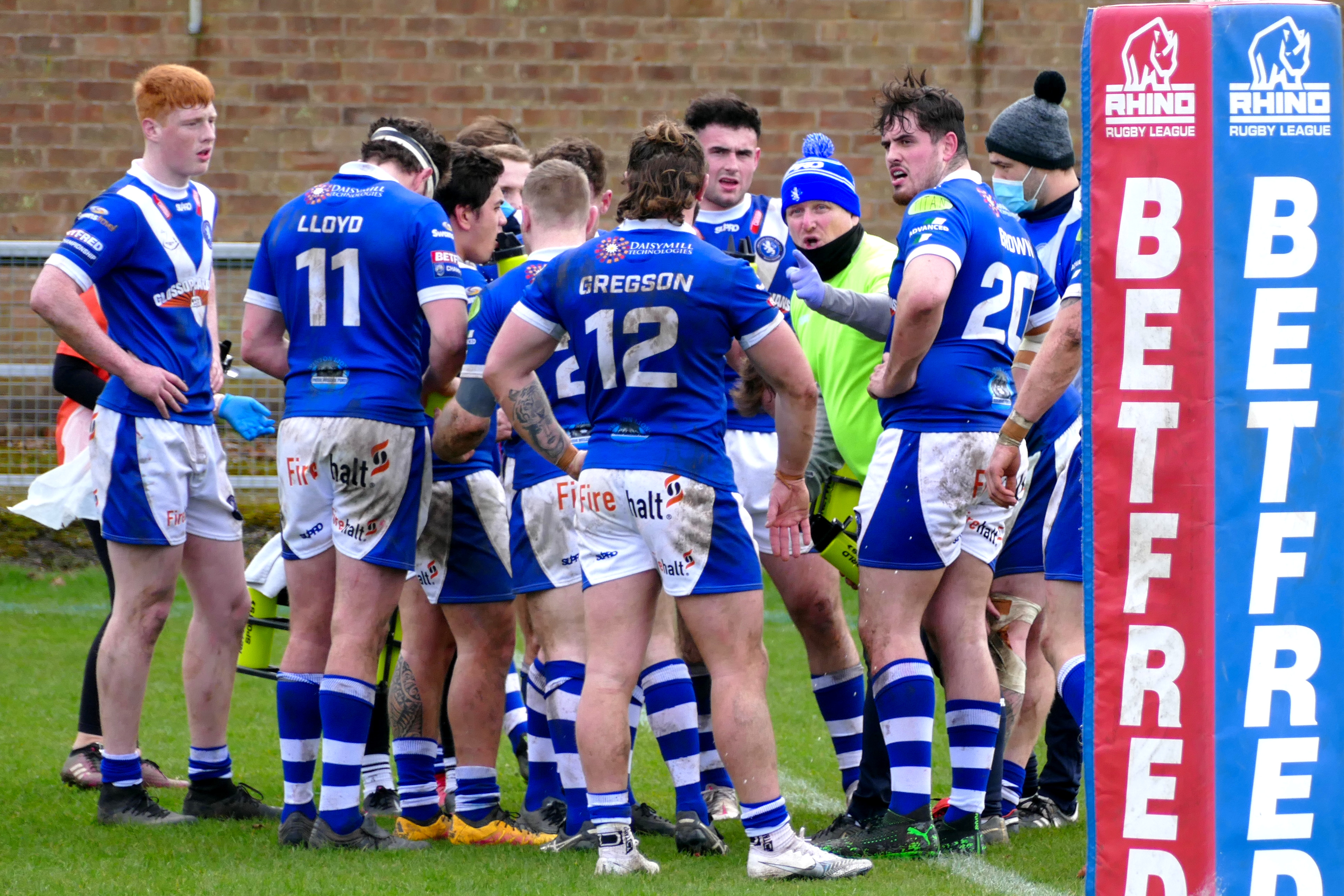 Swinton players gather after Ben Heaton's late try