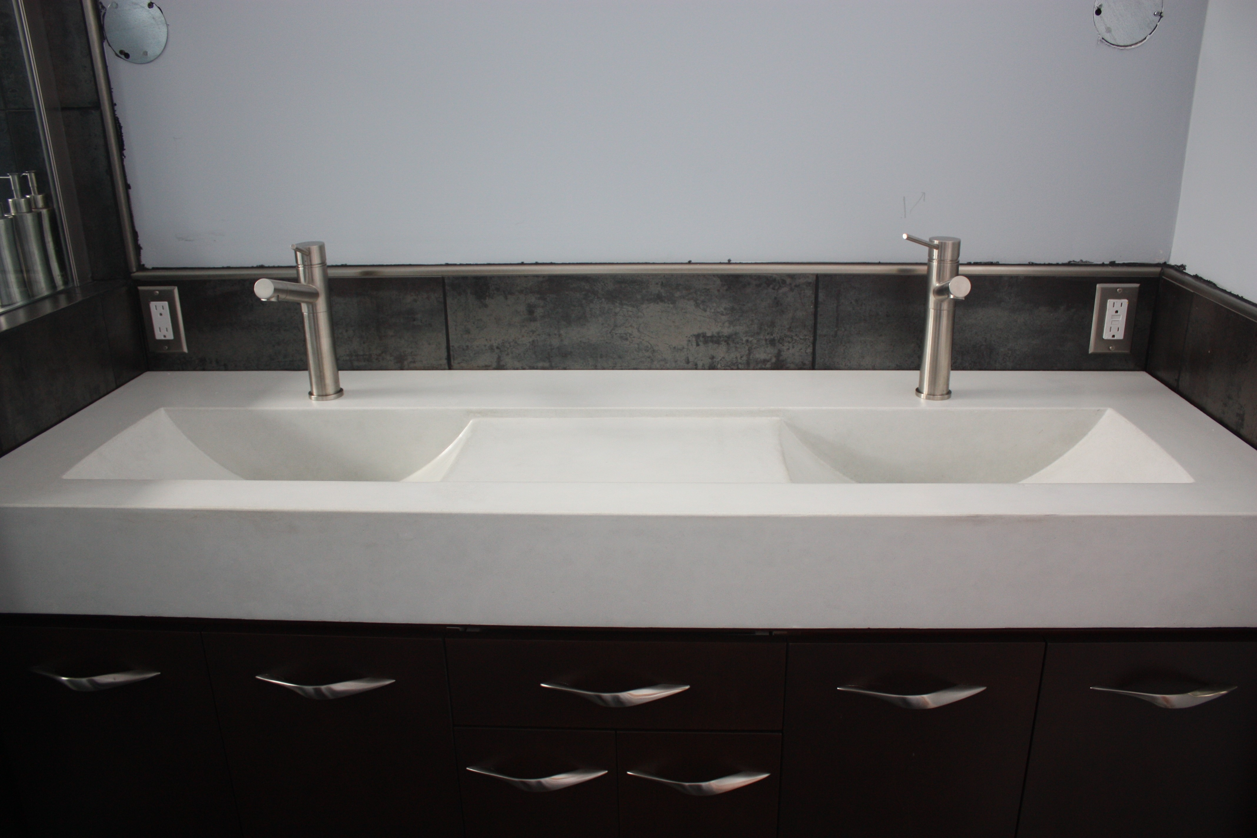 Ideas, long white sink with two silver faucet on the brown wall combined with dimensions 4272 x 2848  .