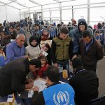 A family submitting an application at the UNHCR registration center in Tripoli, Lebanon. Photo: Mohamed Azakir / World Bank