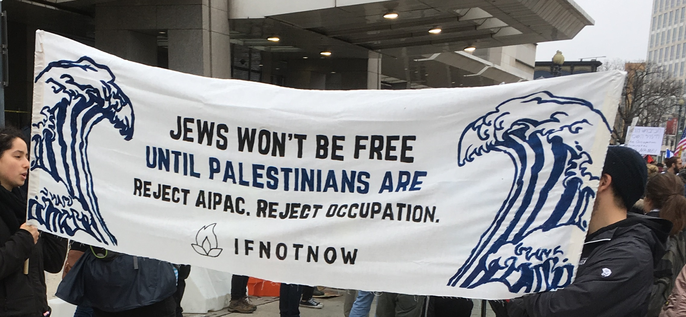 IfNotNow AIPAC conference - sign reading jews won't be free until Palestinians are