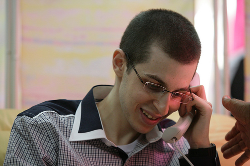 SFC Gilad Shalit on the phone with his parents, after arriving Israel, (c) some rights reserved, ID